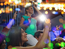 Friends with smartphone taking picture at concert Stock Photography