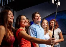 Friends with smartphone taking selfie in club Stock Image