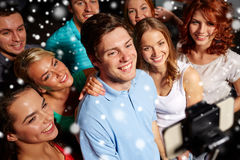 Friends with smartphone taking selfie in club Royalty Free Stock Images