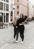 Friends smiling and walking in the old city stock photography