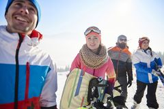 Friends with snowboards and skis Stock Images
