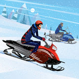 Friends snowmachine race. People riding on a snowmobile - winter sport concept Royalty Free Stock Images