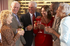 Friends Socializing At A Bar. Together Royalty Free Stock Photos