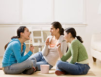 Friends socializing and eating ice cream. Happy friends socializing and eating ice cream Stock Image