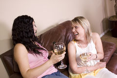 Friends Socializing at Home Royalty Free Stock Image