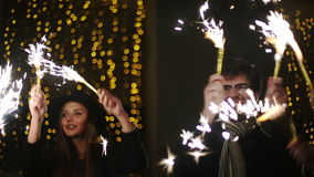 Friends with sparklers dancing stock footage
