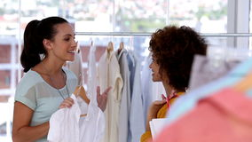 Friends speaking together in a clothing store stock footage