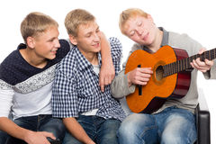 Friends spend leisure time playing the guitar Royalty Free Stock Image