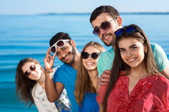 Friends spend a weekend at sea. Stock Image
