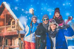Friends spend winter holidays at mountain cottage. Best friends spend winter holidays at mountain cottage Royalty Free Stock Images
