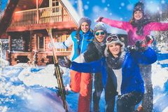 Friends spend winter holidays at mountain cottage. Best friends spend winter holidays at mountain cottage Stock Photo