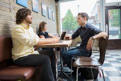 Friends Spending Leisure Time In Cafe Stock Photos