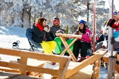 Friends spending time together in cafe at ski resort Stock Photo