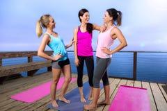 Friends spiritual bond yoga classmates laugh casual conversation friendly before class Royalty Free Stock Photography