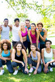 Friends in sportswear at park. Group portrait of multiethnic friends in sportswear at the park stock images