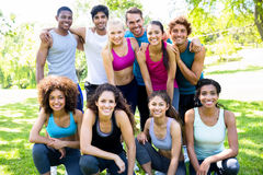 Friends in sportswear at park. Group portrait of multiethnic friends in sportswear at the park royalty free stock images