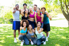 Friends in sportswear showing thumbs up Royalty Free Stock Photography