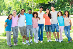Friends standing with arms around Royalty Free Stock Image