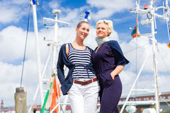 Friends standing at marina pier Stock Photography