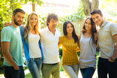 Friends standing outdoors. Happy friends standing at outdoors Royalty Free Stock Image