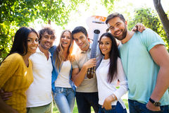 Friends standing outdoors together. Group of a happy friends standing outdoors together Royalty Free Stock Image