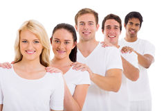 Friends standing row Stock Image