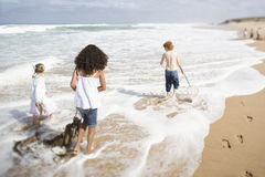 Friends Standing On Surf Royalty Free Stock Photography