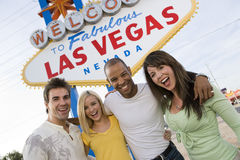 Friends Standing Together Against 'Welcome To Las Vegas' Sign Royalty Free Stock Photos