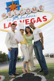 Friends Standing Together Against 'Welcome To Las Vegas' Sign Royalty Free Stock Photo