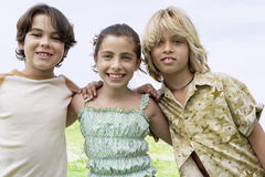 Friends Standing Together With Arms Around Stock Image