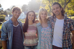 Friends standing together in park Royalty Free Stock Photos