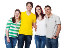 Friends standing together and smiling Stock Photography