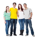 Friends standing together and smiling Stock Images