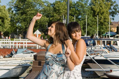 Friends staying near boats Royalty Free Stock Photo