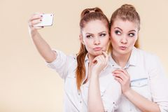 Friends student girls taking self photo with smart phone Stock Photos