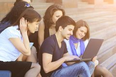 Friends of the students looking at the laptop screen. Education concept Royalty Free Stock Image