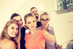 Friends students taking self photo with tablet. Fun bonding selfie concept. Group of diverse friends students classmates taking self photo with tablet pc royalty free stock photos