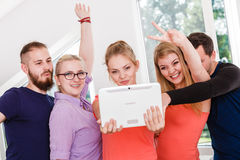 Friends students taking self photo with tablet. Fun bonding selfie concept. Group of diverse friends students classmates taking self photo with tablet pc stock photography