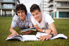 Friends studying. Two friends studying at the park Stock Photography