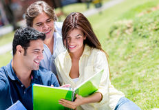 Friends studying at the park Royalty Free Stock Photos