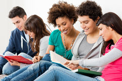 Friends Studying Together. Group Of Happy Young Friends Studying Together Royalty Free Stock Image