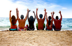 Friends success at the beach Stock Photos