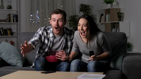 Friends suffering a blackout during tv sports match. Frustrated friends suffering a blackout during tv sports match at home stock video footage