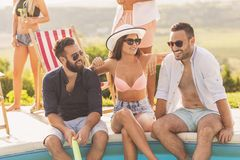 Friends at a summertime poolside party royalty free stock image
