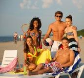Friends sunbathing on a beach Stock Photo