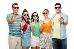 Friends in sunglasses showing ok hand sign Royalty Free Stock Photography