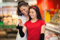 Friends in Supermarket Stock Images