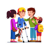 Friends supporting boy with bandage on broken leg. School friends girls, boys supporting teenage boy with bandage on broken right leg standing using crutches Royalty Free Stock Images