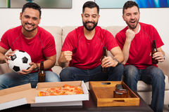 Friends supporting their soccer team Royalty Free Stock Photography