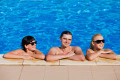 Friends in the swimming pool Stock Photos